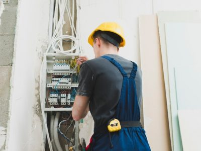 young-man-working-with-wires-switcher_23-2147743118